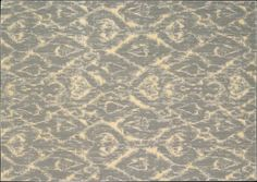 Isn't this beautiful?  A bit more than you were going to spend, but very pretty with some tans and bluish gray - $2495 Peerless Rugs: Savona - Grey