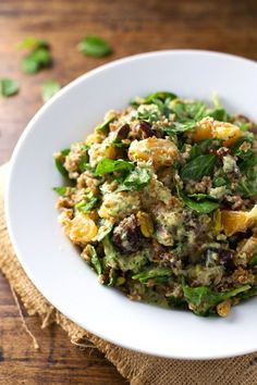This Moroccan Salad with Cilantro Orange Dressing is packed full of yummy flavors. Pistachios, dates, bulgur, spinach, oranges. #vegan #vegetarian #healthy #cleaneating | pinchofyum.com