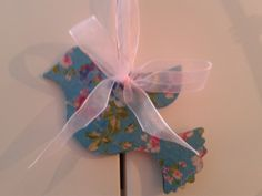 Hanging bird ornament (things I made). Wooden stencil with floral paper, and a loop of ribbon to hang. Pretty :)