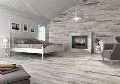 Wood-look tile from wall to wall to ceiling. Many designers are driving this trend across the floor and up the wall. The popularity of reclaimed wood accent walls is exploding, and tile is a great way to pull off the appearance of it. Wood-look tile won't Bedroom Floor Tiles, Wood Bedroom, Bedroom Flooring, Porch Flooring, Tile Flooring, Wood Tile Kitchen, Accent Wall In Kitchen, Kitchen Floor, Faux Wood Tiles