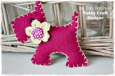 Hand Sewn Magenta Felt Scotty Dog Pin Brooch with Crochet Flower - By Tab Robinson. £5.00, via Etsy.