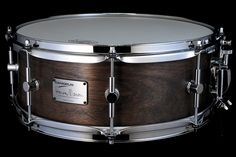 """Canopus 14 x 5.5"""" Harvey Mason signature 'Chameleon' Snare Drum. Features an 8 ply Walnut and Birch 6.4mm thick shell finished in Superior Walnut Oil finish. Equipped with CSA20S lever style snare strainer, 8 Solid Tube Chrome tension Lugs with leather washer """"Bolt Tight"""" tension rods and 2.3mm thick, 17.5mm height chrome plated Steel Hoops."""