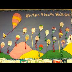 Dr. Seuss week's writing activity.  Students wrote their own rhyming sentence or short poem in the balloon.