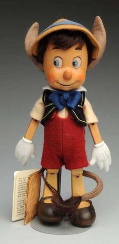 """All wood doll with his """"donkey ears and tail."""" Wrist booklet, but no tag or box. Darling one! Condition (Excellent). Size 10"""" T."""