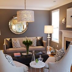 Dark Wall, Light Furniture, and some shine! The dark wall makes the room intimate, but the light furniture make stye room formal and simply chic.