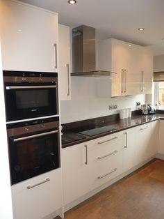 Lovely acrylic doors in cream gloss, Stada Quartz worktops and Siemens Appliances...