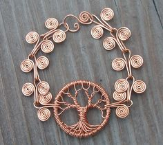 Copper Tree of Life Bracelet with egyption coils. so many tree of life variations here. eg. Love written in the branches, tree guitar