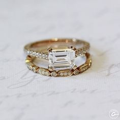 Yellow gold east/west set emerald engagement ring and vintage inspired wedding band. Styles ME2134Q and WR1046.