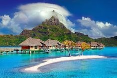 Bora Bora, an island of pristine blue waters, amazing sunsets, overwater bungalows and friendly welcoming people. What more could you ask for? #honeymoon #borabora