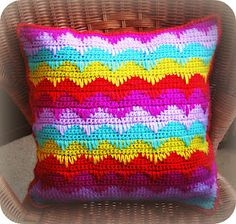 muted colors would look good. Crochet pillow.