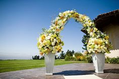 yellow wedding flowers, yellow wedding decor, yellow ross, yellow centerpiece, extavagant, polished creamy lush arch arbor ceremony wedding