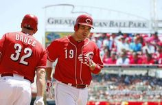 Joey Votto heads to the dugout after his three-run home run in the first inning.
