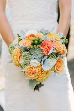 orange and green bouquet, photo by Matt Edge http://ruffledblog.com/southern-inspired-wedding #flowers #weddingbouquet
