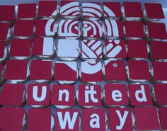 Cupcakes with a custom fondant logo for a corporate account's United Way campaign.
