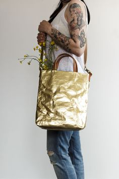 Oh yes, a shiny metallic gold cross body bag that we simply couldn't resist.