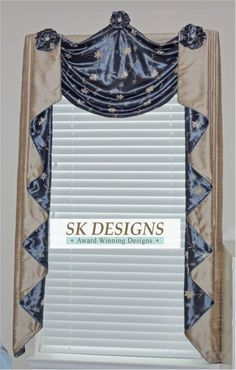 "Raised swag with contrast cascades, choux rosettes and ""bling"" accents on the rosettes. By www.skdesignsblogspot.com."