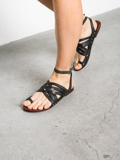 Strappy crisscross leather sandals with toe loop. Adjustable wrap ankle strap. By Free People 100% Leather