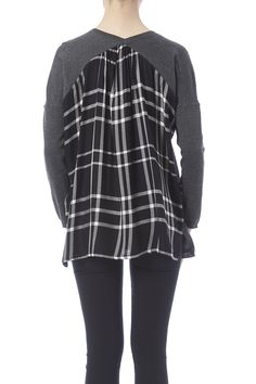 Long sleeve top with plaid back contrast a v-necklineand side slits.  Plaid Back Top by Staccato. Clothing - Tops - Long Sleeve Iowa