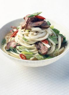 Hot and sour duck noodle soup with baby pak choi