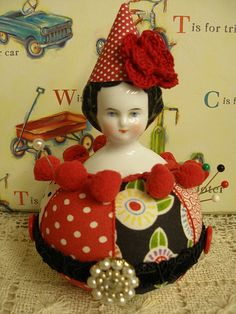so creative.  Love it!    China Doll Poppet Pin Cushion by Garboodles Soup, via Flickr