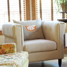 sew pillows with a background that matches your #couch, and is sized to fit either the back or the arms.