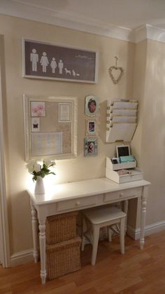 Tuck a narrow desk, mini stool, and hanging storage into a wide hallway to create a designated spot for paying bills and balancing your budget. A pretty desk and an organized memo board can actually adds style to a bare spot while transforming it into a home office.