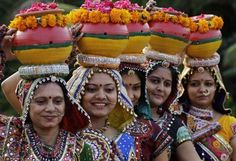 Indian women in traditional attire participate in a practice session of Garba, a traditional dance of Gujarat ahead of Navratri festival in Ahmadabad, India, Sunday, Oct. 7, 2012. Navratri, or the festival of nine nights will begin from Oct. 16.