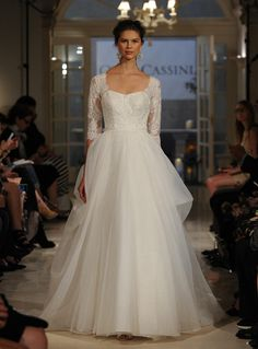 Oleg Cassini at David's Bridal's Fall 2016 Collection Has Lace for Days | https://www.theknot.com/content/oleg-cassini-wedding-dresses-bridal-fashion-week-fall-2016