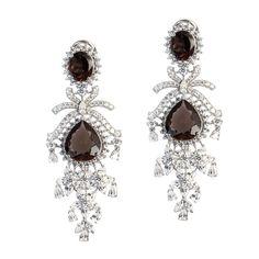 Smokey Oval & Pear Danglings  Product Code : ADERL1400015  Type : Smokey Quartz, Swarovski    Color :Brown    #SilverEarringsOnlineShopping  #SilverEarringsOnlineIndia  #SilverEarringsIndia    #SilverEarringsOnline  #BuySilverEarringsOnline   #SilverEarringsForWomen  #SilverEarring #DesignerSilverEarrings   #BuySilverEarrings  #SilverEarrings  #Earrings