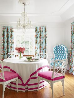 Tropical Style in the Suburbs : Decorating : Home & Garden Television, round dining table, dining room, pink and white tablecloth, pink upholstered dining chairs, bamboo chairs, floral chintz curtains, pink ribbon trimmed tablecloth overlay