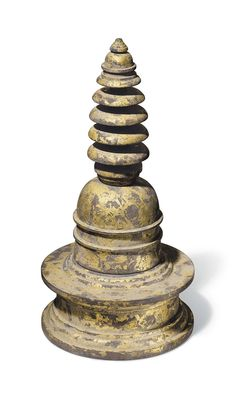 A gray schist stupa with gold leaf. Gandhara, 2nd/3rd century