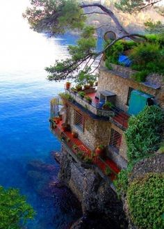 The reds and blues of the seaside of Cinque Terre, Italy - beautiful colors to paint a room perhaps.