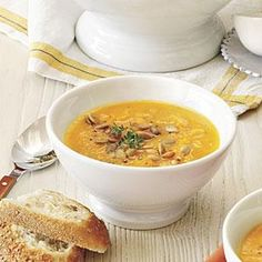 Pumpkin-Acorn Squash Soup |This savory soup is full of the flavors of fall. Pumpkin and acorn squash are seasoned with honey, thyme, ginger, and nutmeg for a delicious combination that will be hard to resist. MyRecipes.com