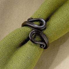 I like the old world blacksmith look of these napkin rings.