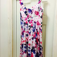 "Floral Dress This is a perfect dress for a spring day! It gives a very flattering figure, as it pulls in at the waist and has beautiful straps that cover that pesky ""armpit fat"". It is a petite and is very well-made. Dress Barn Dresses Mini"