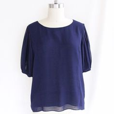 Royal Blue Blouse This elegant and chic chiffon-like blouse has gorgeous pleated sleeves and a zip-back. Can be dressed up or dressed down. Semi sheer fabric, almost like chiffon. Excellent condition. Forever 21 Tops Blouses