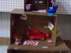 More doll house furniture made out of recycled material -- including a bed, chairs, and flower pots.  They are made out of a variety of pop lids and container lids, and of course some old t-shirts and rags for the rug and bedding.