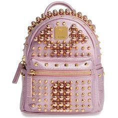 Women's Mcm X Mini Stark Stud Backpack ($1,950) ❤ liked on Polyvore featuring bags, backpacks, prism pink, day pack backpack, shoulder bag, crossbody backpack, mcm backpack and crossbody shoulder bags