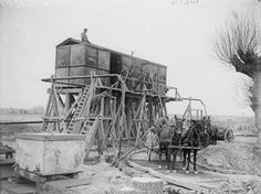 British soldiers filling mule-drawn water-carts at a water depot near Ervillers, 7 May 1917.