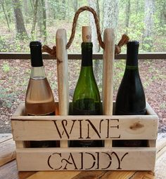 Built from reclaimed pallet wood, this caddy will easily and safely carry one bottle of wine and two glasses, two bottles of wine and one