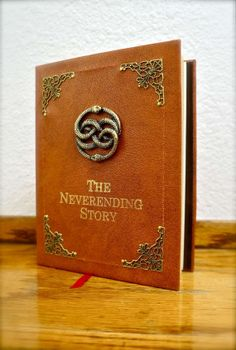 Neverending Story Sketchbook / Diary by GeekifyInc on Etsy, $50.95 - great idea for a baby book / nursery decoration!!!