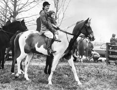 Jackie and Caroline Kennedy riding a horse, March 1963.