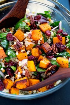 Autumn pearl couscous salad with roasted butternut squash, pecans, dried cranberries and topped with a sweet and tangy dijon vinaigrette. Perfect for fall!