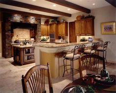 Beautiful! I especially love the tall kitchen chairs and colors of the room.