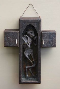 The Faustian Cross ~ The physical manifestation of a lesser daemon, bound in a wooden cross by Jacob Petersson.