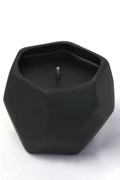Freshen up your room with the scents or jasmine and sugar! Hand-poured black wax candle in slip-cast black porcelain container with illustration. An ongoing collaboration with ceramic artist Sarah Cih