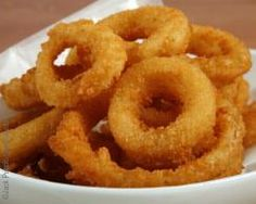 Living Without - Gluten-Free, Dairy-Free Fried Onion Rings - Do you miss fried onion rings? Made with a gluten-free beer batter, these rings are crispy outside and tender inside, just like you remember. Indulge!
