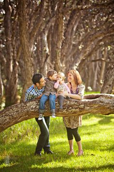 family pose idea. Kids on fallen branch parents behind to stabalize. Could also be done from backside with parents holding hands behind kids backs.
