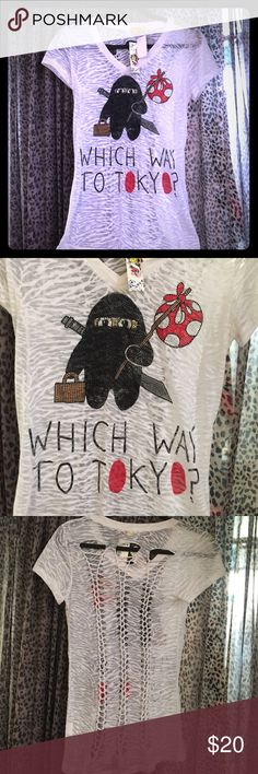 "Bling Graphic tee, Size L, cut-out back Bling Graphic tee, Size L cut out back, white see through , reads: ""Which way to Tokyo?"", pair with skinny jeans or leather pants and  👠 Tops Tees - Short Sleeve"