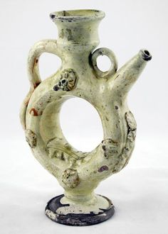 196 - RING-SHAPED JUG  Late 19th century - early 20th century h.: 21 cm d.(mouth): 5.4 cm d.(base): 7.5 cm d.(body): 13 cm